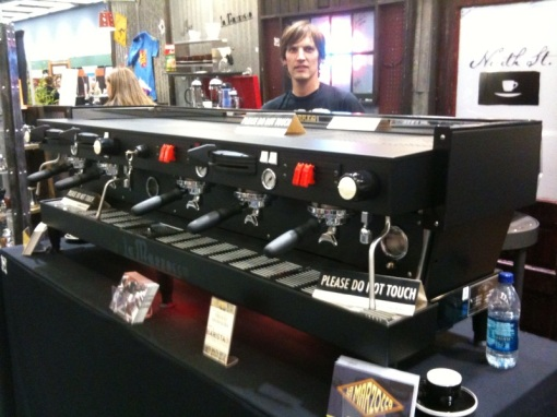 Killer custom Knight Rider La Marzocco Linea from Espresso Parts! Joined 2 and 3 group Mechanical Paddle Linea with two groups reverted to semi-auto, all stealth black finish, and with sliding LED lights on the bottom. No, it doesn't talk.